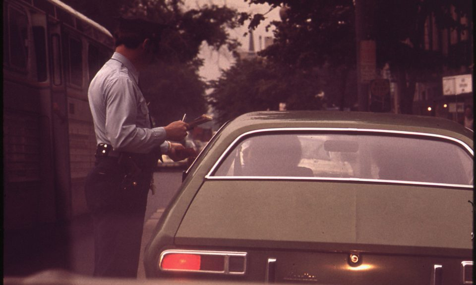 vintage photo of driver being ticketed by police officer